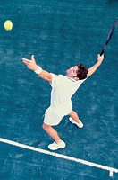 High angle view of man serving a tennis ball
