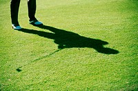 Shadow of a person playing golf