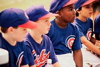 Little league baseball team sitting together