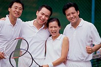 Portrait of a group of people at a tennis court