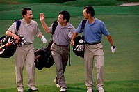 Three men carrying golf bags at a golf course