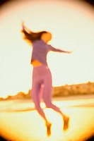 Low angle view of a young woman dancing (thumbnail)