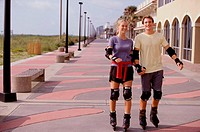 Young couple in-line skating