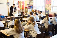 Teacher teaching a classroom of 12-13 year old children in a comprehensive school, Sheffield
