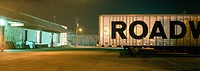 Truck trailer in industrial area at night. California. USA