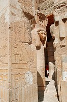 Statue peers from behind columns at Deir el-Bahri (Mortuary Temple of Hatshepsut. Luxor, Egypt