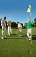 Young and Old Men on a Putting Green Playing Golf