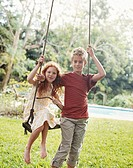 Portrait of Brother and Sister By a Swing