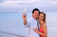 Couple taking photos of themselves with a camera phone