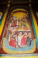 Bright painting on church wall in traditional style, depicting scenes from a religious story, Axum (Aksum), northern Ethiopia