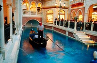 Gondola rides are offered in the Grand Canal shopping area of the Venetian Hotel and Casino. Las Vegas. Nevada, USA
