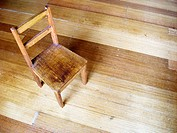 Small wooden chair on wooden floor