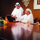 Arab businessmen meeting in conference room