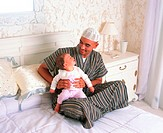 Father and toddler on bed (thumbnail)