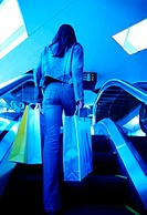 Woman with shopping bags in a shopping mall (thumbnail)