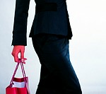 Woman holding a shopping bag (thumbnail)