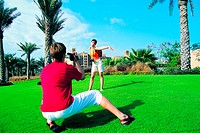 Western tourists photographing in front of Mina Al Salam hotel, Dubai, United Arab Emirates