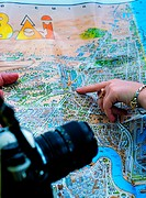 Tourists looking at city map of Dubai
