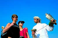 Western tourists visiting Arab falconer in the United Arab Emirates (thumbnail)