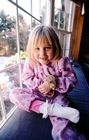 A little girl and her pet hamster. Pennsylvania. USA