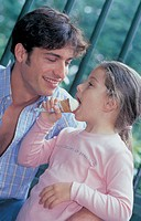 man and little girl eating a ice-cream