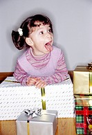 one little girl with presents
