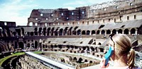 europe, italy, lazio, roma, tourist with electronig guide at the colosseo