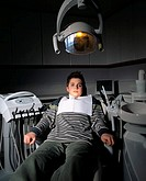 Frightened boy in dentist´s chair