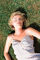 Young woman lying on lawn