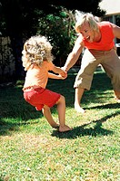 Father playing in garden with daughter