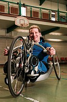 Disabled man using adapted bicycle (thumbnail)