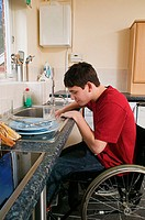 Disabled man washing up