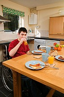 Disabled man having breakfast