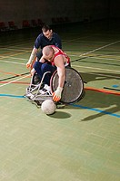 Disabled man playing basketball