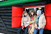 Friends outside a wooden hut