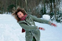 Woman in snowball fight
