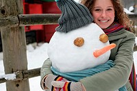Woman hugging a snowman