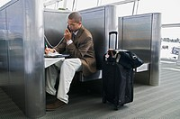 Businessman on phone at airport