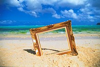 Picture frame stuck in sand