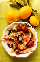 Ravioli with scampi, tomatoes and olives, lemons