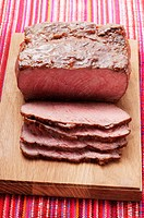 Roast beef on chopping board
