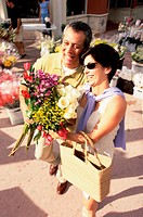High angle view of a mature couple holding a bouquet of flowers (thumbnail)