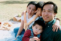 Portrait of parents with their children at a picnic