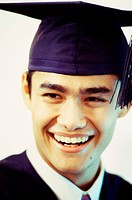 Close-up of a young male graduate smiling