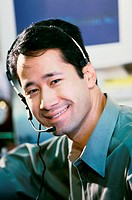 Portrait of a businessman wearing a headset smiling
