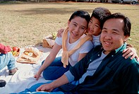 Portrait of parents with their son at a picnic