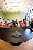 Portrait of a group of business executives sitting in a conference room (thumbnail)