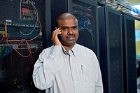 Portrait of a male technician using a mobile phone