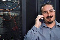 Portrait of a male technician talking on a mobile phone