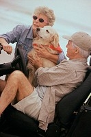 Senior couple with their dog